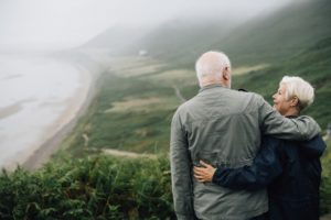 Elderly Couple Looking At Scenery